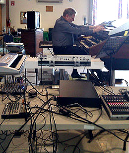 jim Gregory surrounded by electronic gear and keyboards