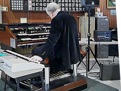 Don simultaneously plays a Yamaha keyboard and the X66 Hammond.